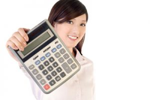 Image of a woman holding a calculator