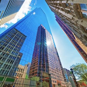 A photo of reflective skyscrapers, taken from a pedestrian's viewpoint