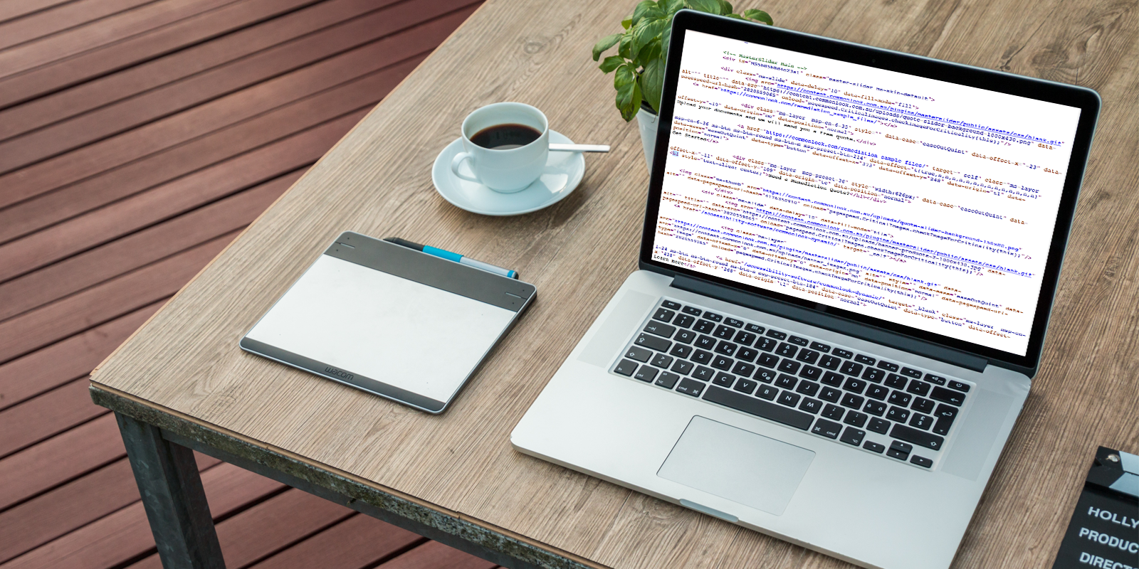 Laptop screen showing backend html and CSS code