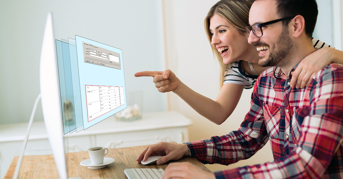 A man and woman smile and point at a computer screen as the tables in it come to life in 3D